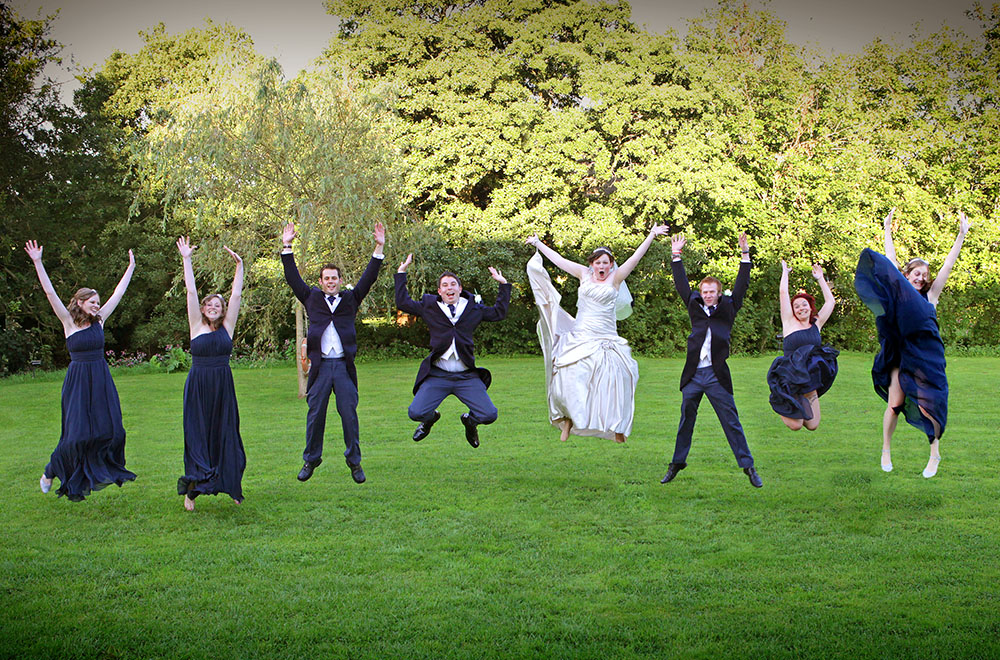 Wedding party jumping in air
